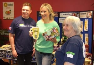Gosport MP, Caroline Dinenage, puts Fairtrade into her break , at the Co-op stall at the Discovery Centre event