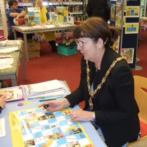 Councillor Lynn Hook, Mayor of Gosport, 2016-17, plays Breaks and Ladders it  Fairtrade Fortnight event